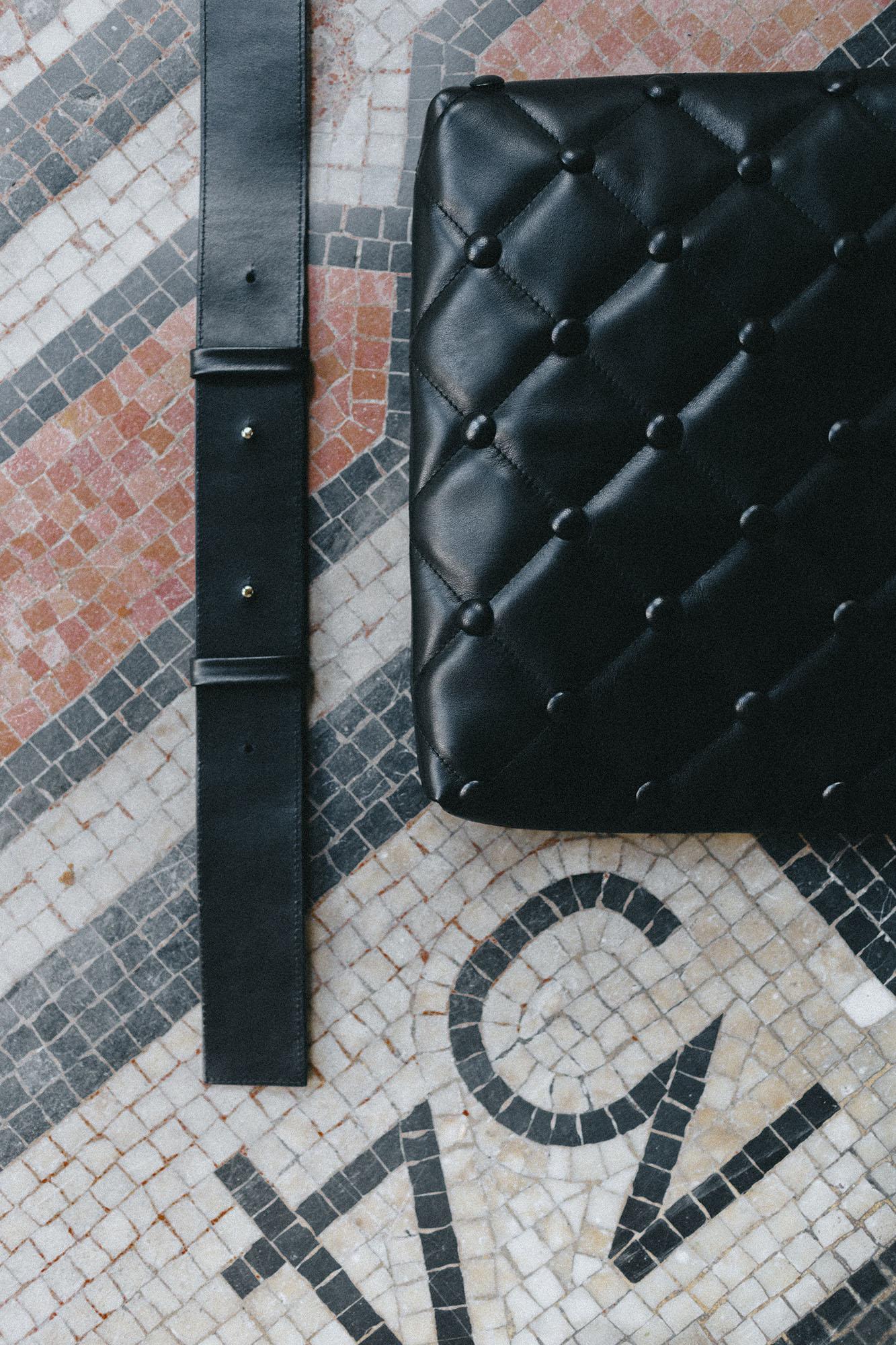 Laimushka black leather handbag with shoulder strap on the floor in Paris, Palais Royal
