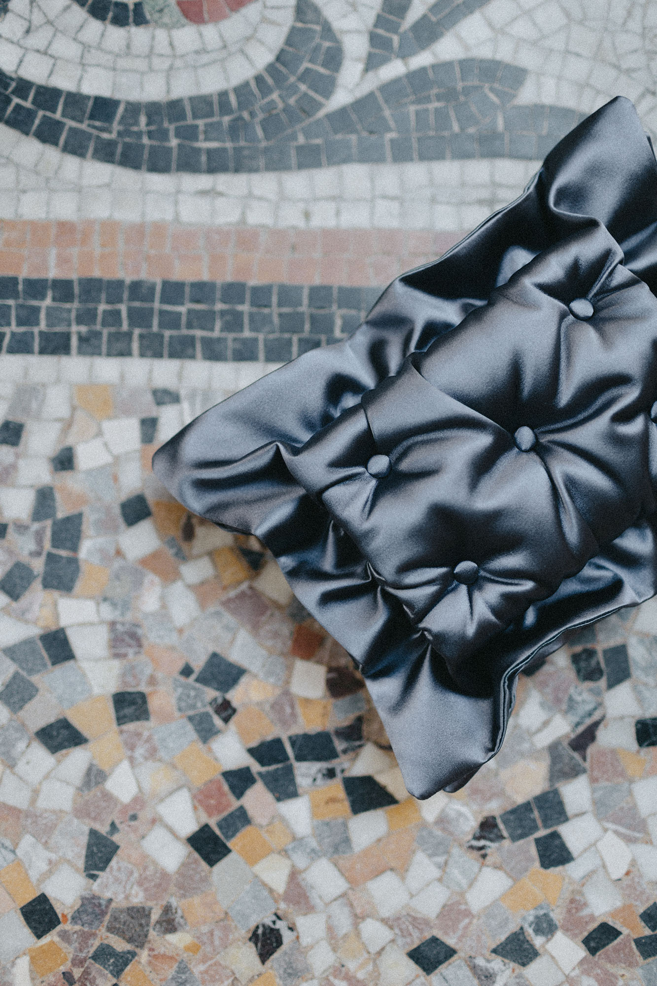 Laimushka dark grey quilted silk pillow clutch bag on the floor in Paris, Palais Royal