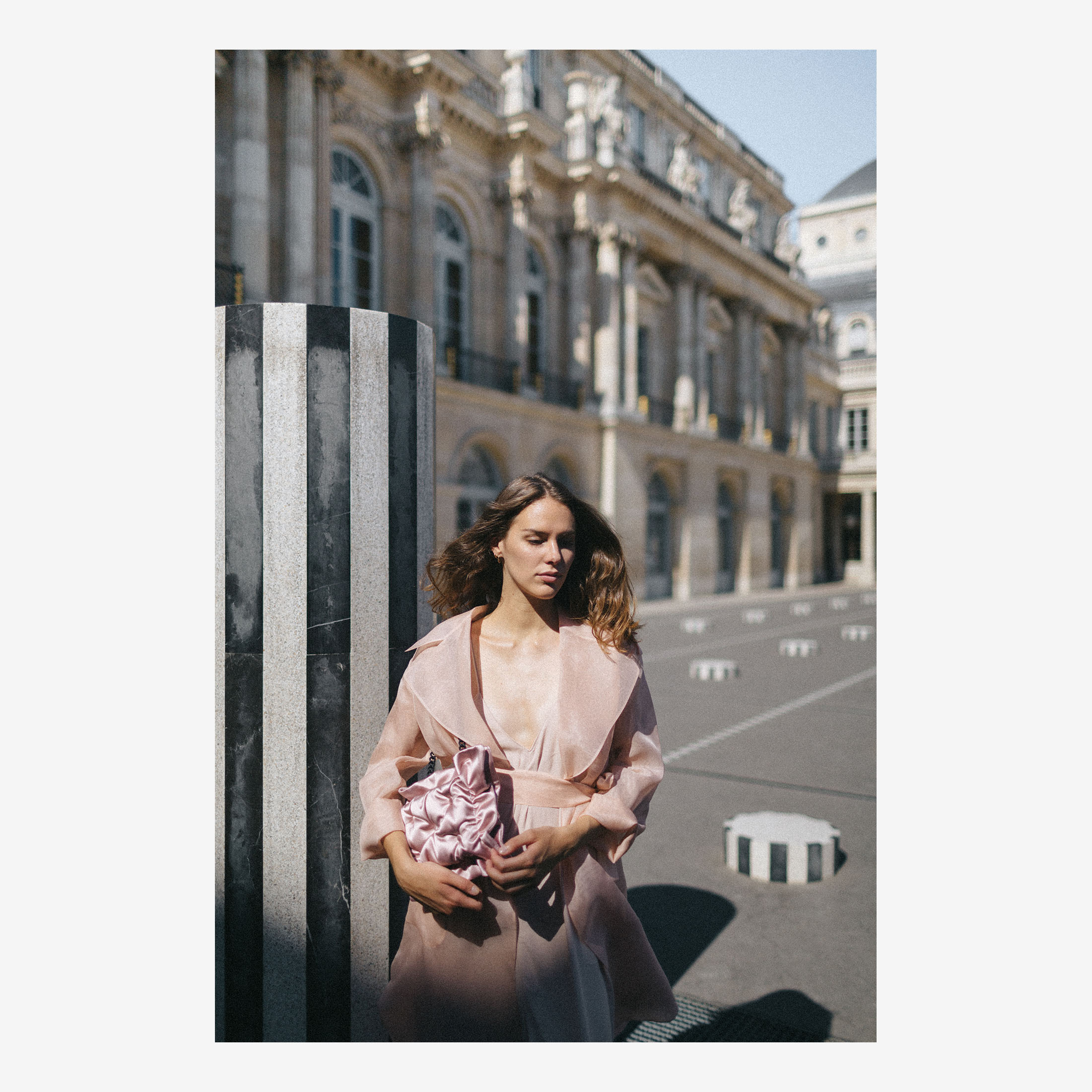 Woman in front of Colonnes de Buren in Palais Royal with Laimushka silk pillow bag