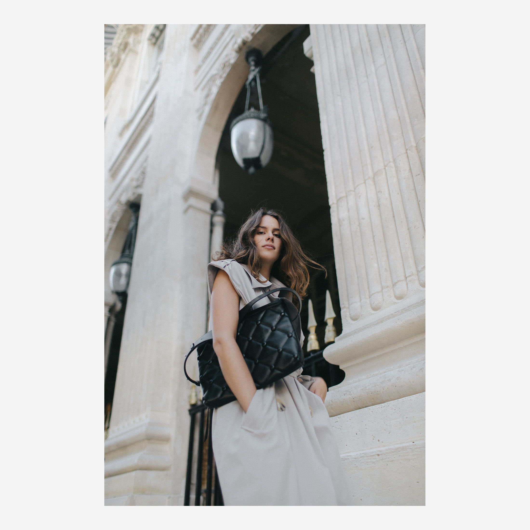 Model with Laimushka black leather oversized clutch in Paris, Palais Royal