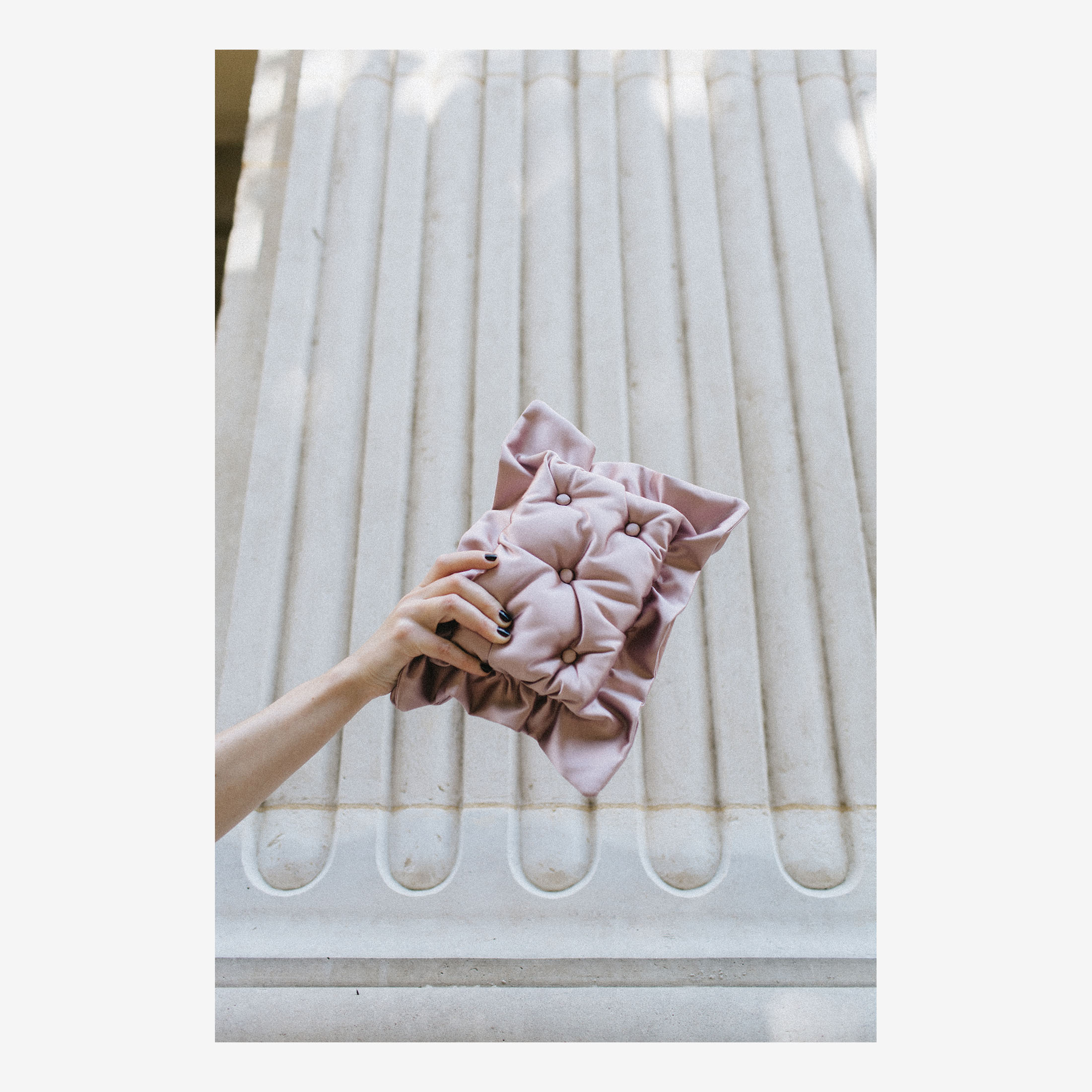 Laimushka blush pink quilted silk pillow clutch bag on the floor in Paris, Palais Royal