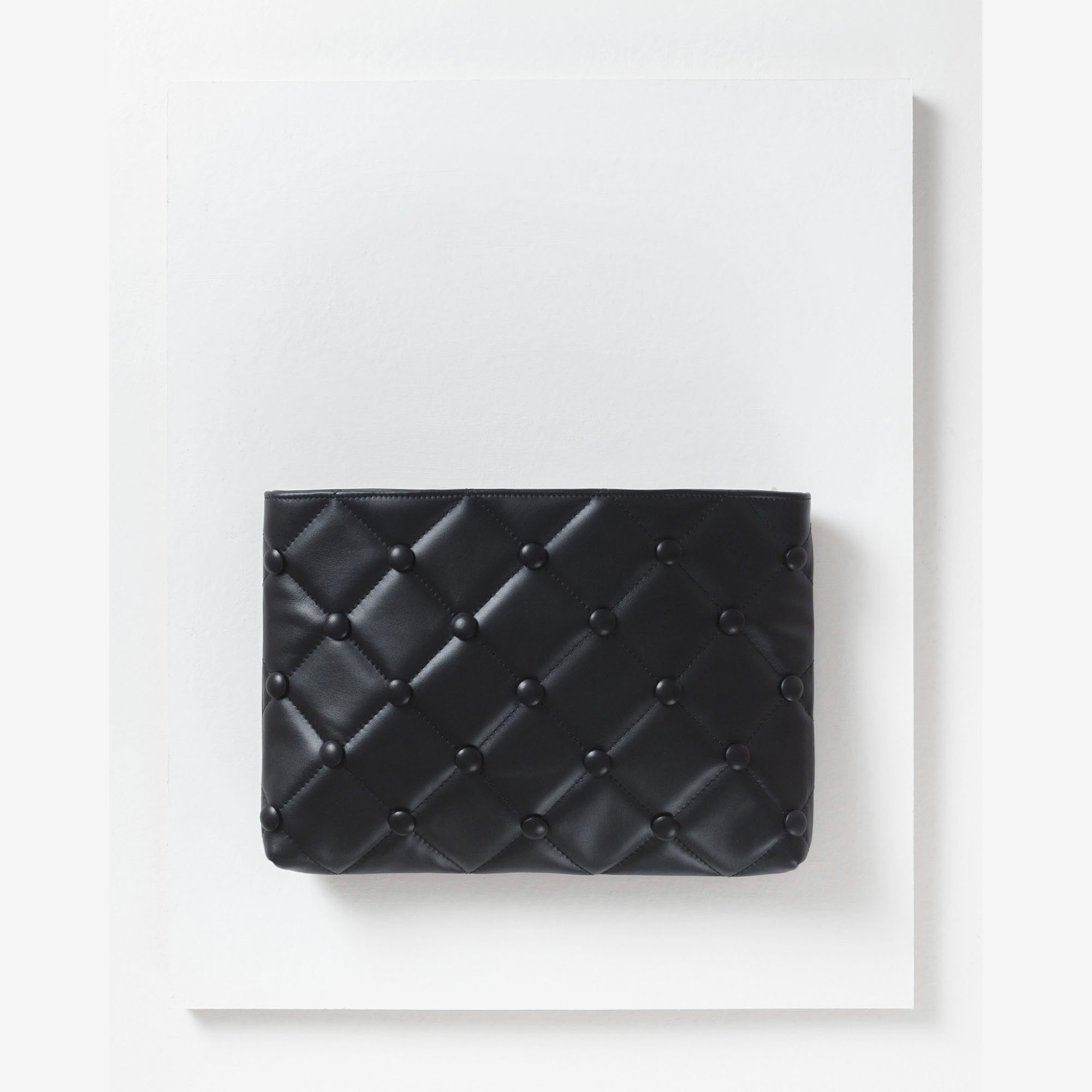 Laimushka black leather quilted oversized clutch bag