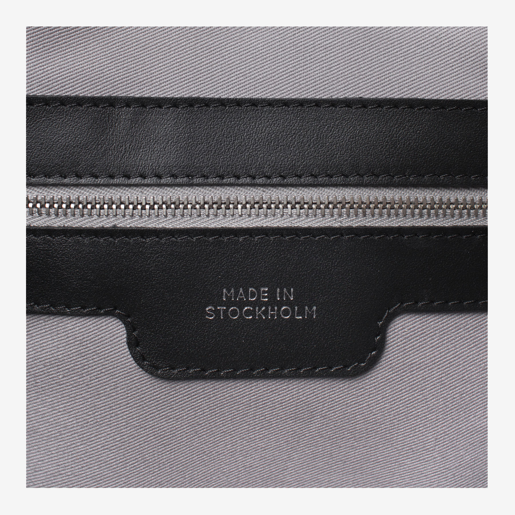 Laimushka leather bag's interior zip pocket with tag Made in Stockholm